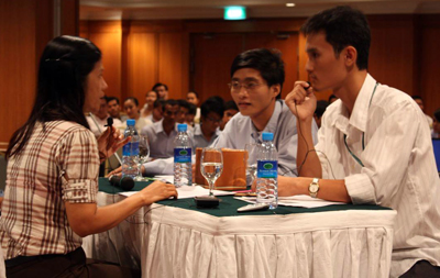Participants of the client counseling competition interacting with an actor posing as a client.