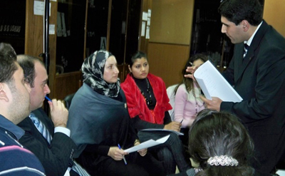 During a training, legal aid practioners prepare to offer services in Northern Lebanon.