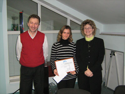 Alena Terzi, from the Comrat Legal Clinic, receives her certificate from Emil Darii and Leslie Reed of ABA/ROLI
