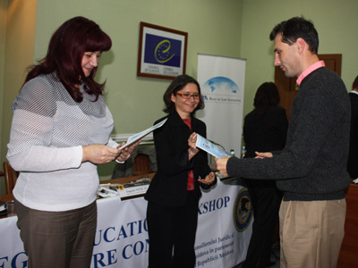 A workshop participant receives certificate of participation from Moldovan U.S. Embassy Resident Legal Advisor Sarah Lum.