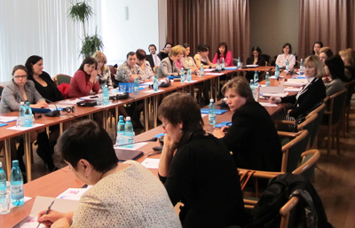 About 60 women judges, prosecutors, defense attorneys and law students attended the late-April symposium, sharing their experiences and views.